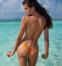 Brazilian beauty Izabel Goulart in the Sports Illustrated Swimsuit Issue 2012. Including pics from the arrival to the Letterman show, and from the SI launch