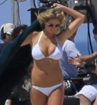 Kate Upton running around in a skimpy bikini for a film role.
