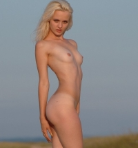 Femjoy Vika stripping naked outdoor showing off her blond puffy pussy and nice young tits